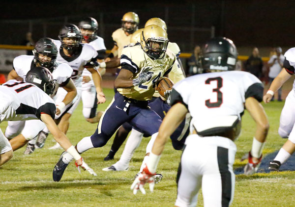 Lelon Dillard of Desert Vista HS evades tacklers.